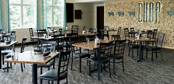 Restaurant metal chairs and wood table tops